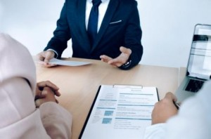 Business situation, job interview concept. Job seeker present resume to managers.